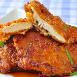 Baked Chicken Tenders In A Marinate Spicy Sauce