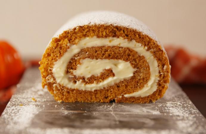Pumpkin Roll Cake With Orange Cream Cheese.