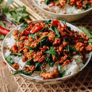 Basil Chicken is Served Along With Steamed Rice